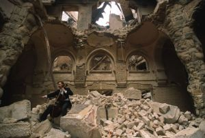 Vedran Smajlović, Cellist of Sarajevo, performs in 1992, in partially destroyed Nacionalna biblioteka BiH, Vijećnica